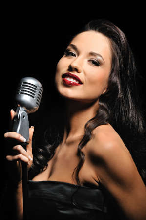 Portrait of a beautiful brunette with a retro microphone  Stock Photo - 6724600
