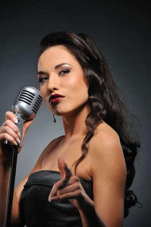 Beautiful brunette woman singing Stock Photo - 6724686