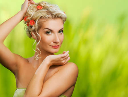 hair spa:   Beautiful young woman with fresh flowers in her hair. Spring concept.