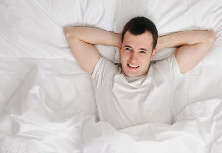 Happy man wakening up Stock Photo - 6724592
