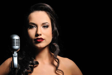 Attractive brunette woman with a retro microphone   photo