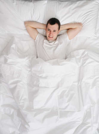 Happy man wakening up Stock Photo - 6724506