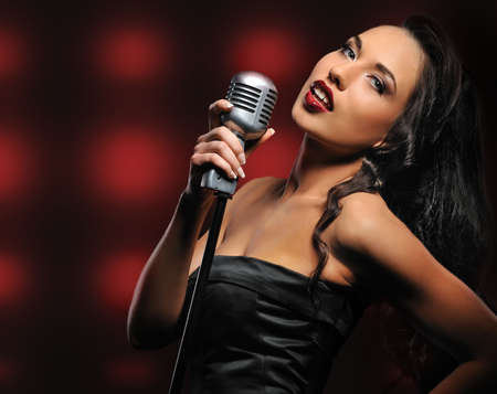 Beautiful singer over abstract background Stock Photo - 6724503