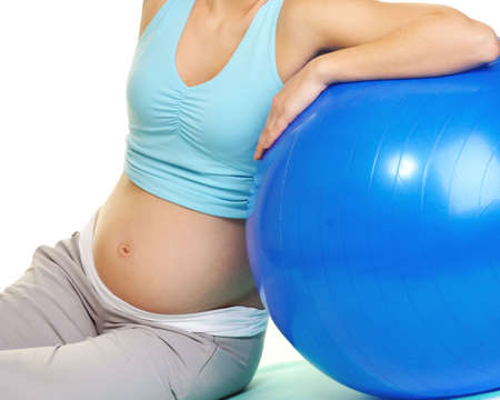 Young pregnant woman making exercise with a fitness ball  photo