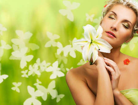 natural cosmetics:  Beautiful young woman with fresh flowers in her hair. Spring concept.