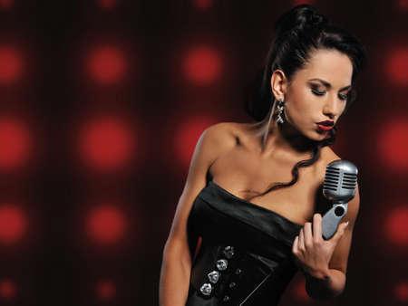 stage makeup:  Beautiful brunette woman singing   Stock Photo