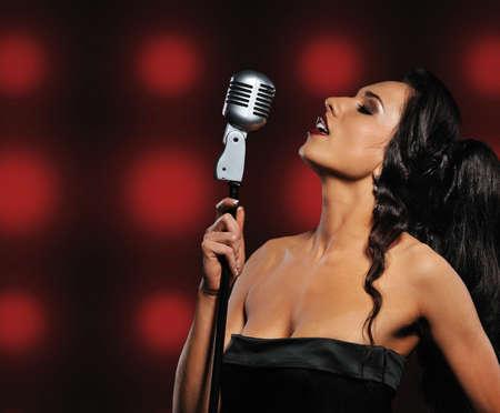Beautiful brunette woman singing Stock Photo - 6724652