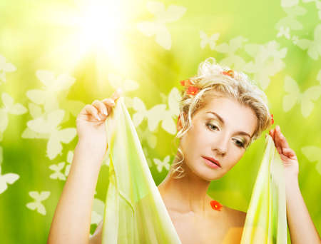 eautiful young woman with fresh flowers in her hair. Spring concept.  photo