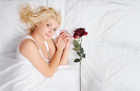 Dreaming woman with red rose photo