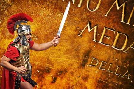 gladius: Roman legionary soldier in front of abstract background Stock Photo