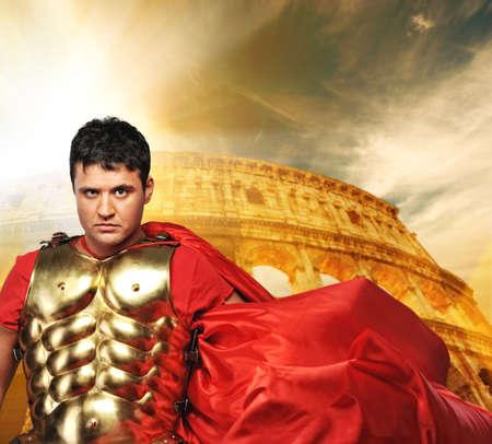 roman amphitheater: Roman legionary soldier in front of coliseum Stock Photo