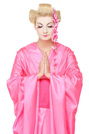 Portrait of a praying geisha photo