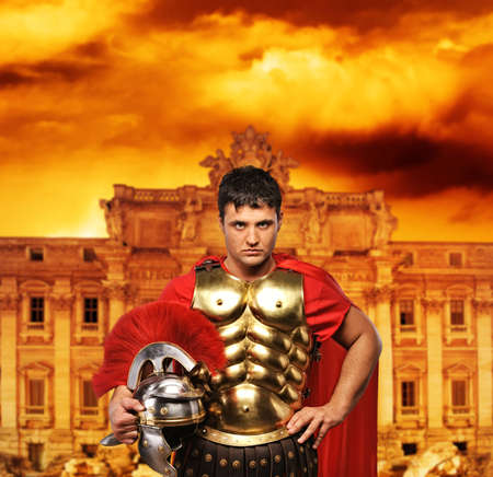 Roman legionary soldier in front of Trevi fountain Stock Photo