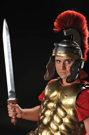 gladius: Handsome legionary soldier with a gladius Stock Photo