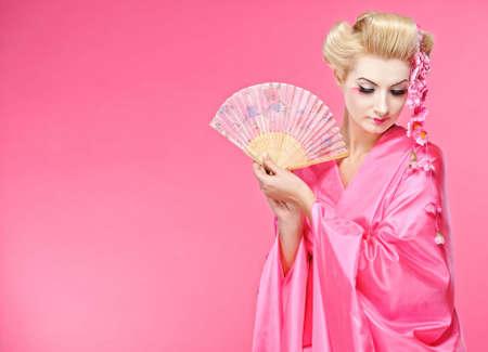 Beautiful geisha with a fan Stock Photo - 6745262