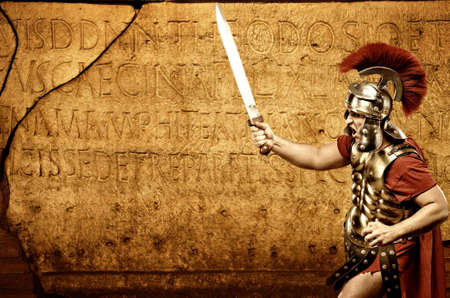 Roman legionary soldier in front of abstract wall Stock Photo - 6745237