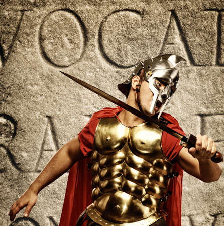 Roman legionary soldier in front of abstract wall photo