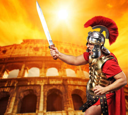 Roman legionary soldier in front of coliseum photo
