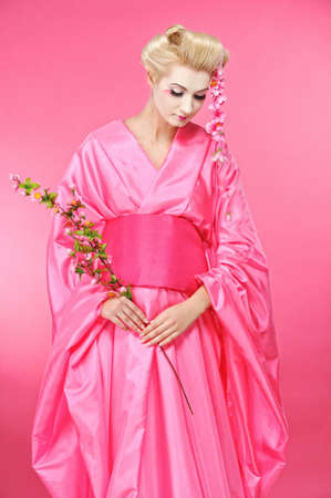 Beautiful geisha with a  sacura photo