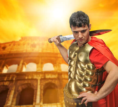 legionary:  Roman legionary soldier in front of coliseum   Stock Photo