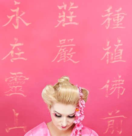 Close-up portrait of a beautiful geisha photo