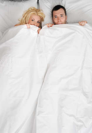 Funny young couple in a bed photo