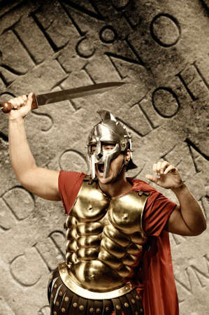 gladiator: Roman legionary soldier in front of abstract wall   Stock Photo
