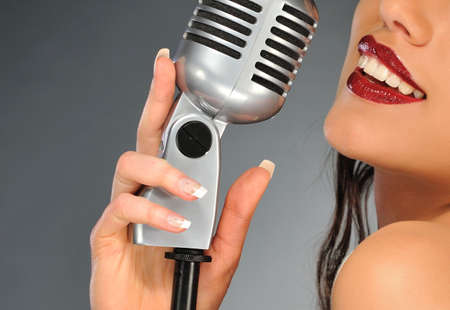 Woman with a retro microphone photo
