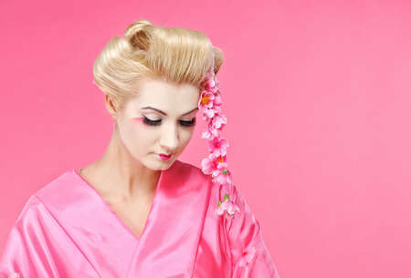 Portrait of a beautiful geisha Stock Photo - 6786658