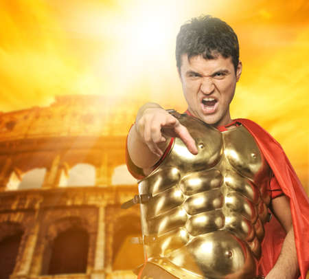 Angry roman legionary soldier in front of coliseum photo