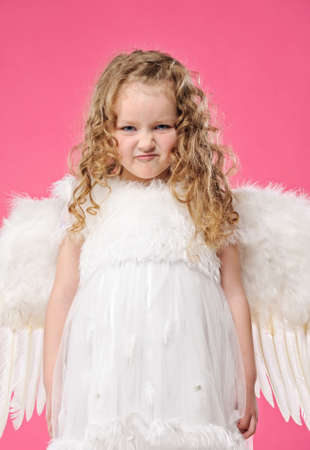 artificial hair: Little angel girl making funny face