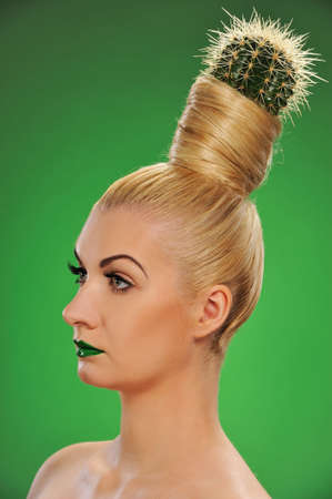 Woman with cactus in her hair   photo