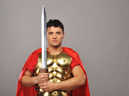 Handsome roman legionary soldier   photo