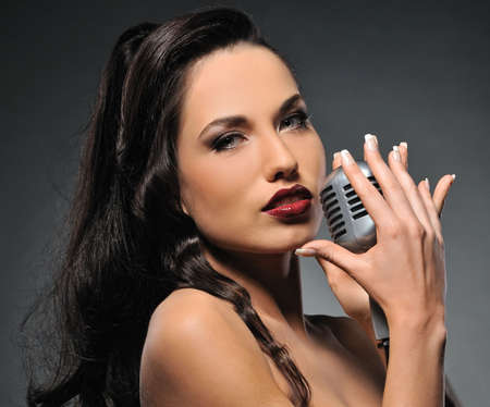 Beautiful brunette woman singing  photo