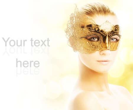Beautiful young woman in carnival mask Reklamní fotografie