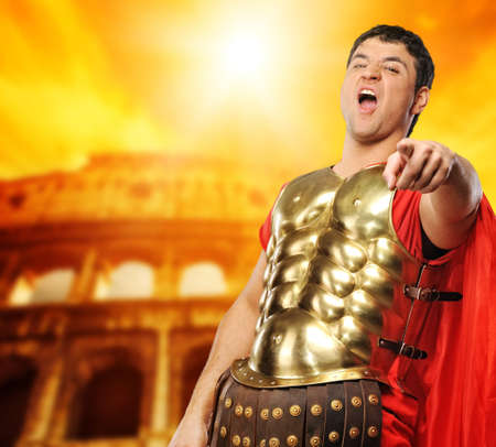 Legionary soldier in front of coliseum photo