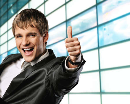 Happy businessman showing his thumb up with smile Stock Photo - 6881951