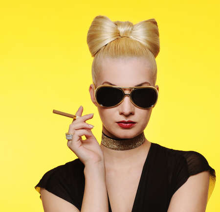 glamorous: Beautiful charming lady with a cigarette Stock Photo