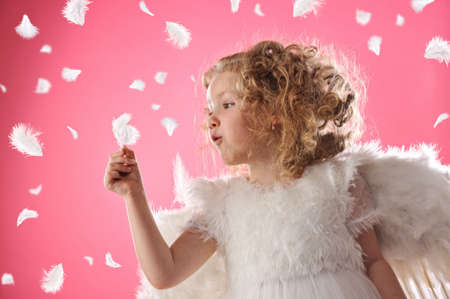 Beautiful angel girl holding a feather Stock Photo - 6882086
