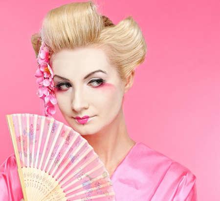 Beautiful geisha with a fan photo