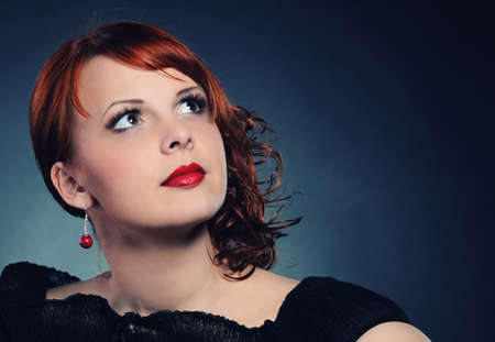 Portrait of an attractive redhead woman photo