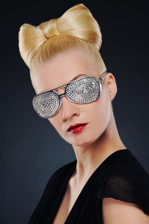 Close-up portrait of a beautiful woman in stylish glasses Stock Photo - 6976495