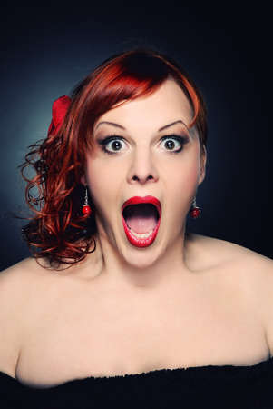 Screaming attractive redhead woman photo