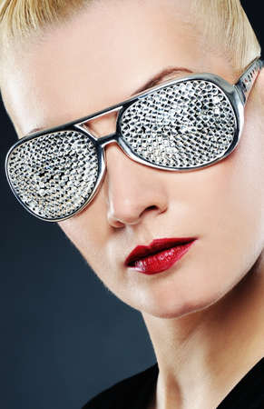 Close-up portrait of a beautiful woman in stylish glasses Stock Photo - 6976461