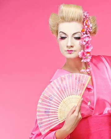 Beautiful geisha with a fan Stock Photo - 6976458