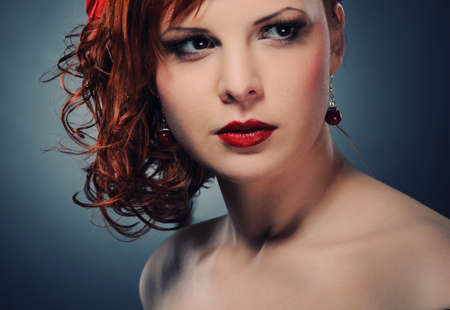 Portrait of an attractive redhead woman Stock Photo - 6976549