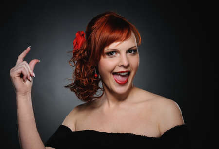 Portrait of an attractive redhead woman Stock Photo - 7003544