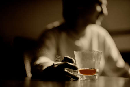 Smoking man with a glass of whisky and cigar Stock Photo - 7028765