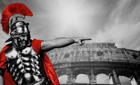 legionary: Angry legionary soldier in front of coliseum Stock Photo
