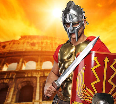 Roman legionary soldier in front of coliseum Stock Photo
